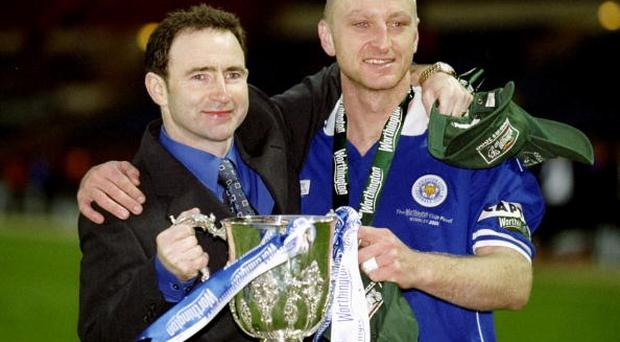 27 Feb 2000: Martin ONeill and Matt Elliott of Leicester City hold the cup in celebration after the Worthington Cup Final victory over Tranmere Rovers played at Wembley Stadium in London. The Match finished Leicester City 2 Tranmere Rovers 1. \ MandatoryCredit: Ross Kinnaird /Allsport