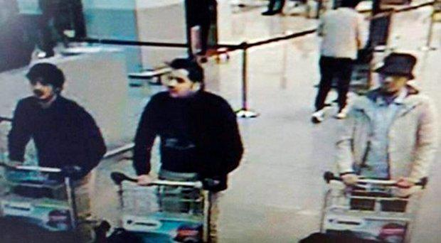 This CCTV image from the Brussels Airport surveillance cameras made available by Belgian Police, shows what officials believe may be suspects in the Brussels airport attack on March 22, 2016