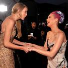 Singers Taylor Swift (L) and Katy Perry arrive at the 2011 American Music Awards held at Nokia Theatre L.A. LIVE on November 20, 2011 in Los Angeles, California. (Photo by Lester Cohen/AMA2011/WireImage)