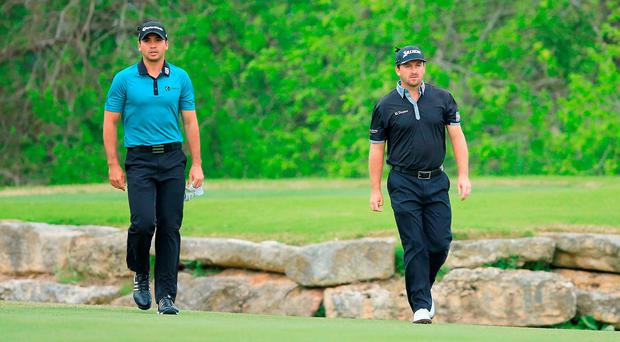 Jason Day of Australia (L) and Graeme McDowell of Ireland