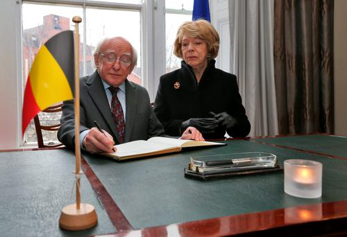 President Michael D Higgins and his wife Sabina at the Belgian Embassy in Ballsbridge, Dublin, yesterday, as they signed the book of condolences for the victims of the Brussels attacks, which he condemned as 'terrible' and 'cowardly'. Photo: Colin Keegan