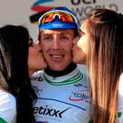 Etixx-QuickStep's Irish rider Daniel Martin celebrates with the trophy on the podium after winning stage 3 of the Volta a Catalunya (Getty Images)