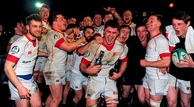 Dublin University players celebrate their victory over UCD in last night's Annual Rugby Colours in Trinity (SPORTSFILE)