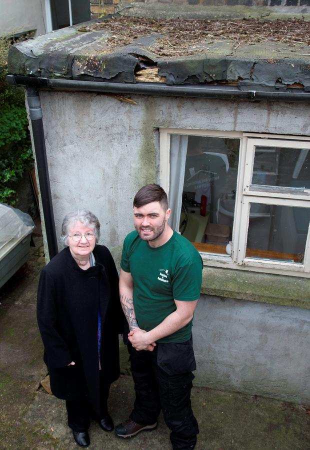 May King pictured with her Building Contractor, James Ormond and her badly decayed roof at her South Dublin home