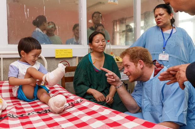 Prince Harry meets young burns victim Pemba Sherpa, 5 and mother Doma at Kanti Children's Hospital on the final day of his tour of the country on March 23, 2016 in Kathmandu, Nepal. Established in 1963 the hospital has a capacity of 320 beds and treats children up to the age of 14. Many of it's patients have been injured whilst living in the hazardous environments of the camps following the earthquake. (Photo by Adam Gerrard - Pool/Getty Images)