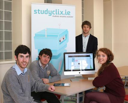 Teacher Luke Saunders with Studyclix users, from right to left, Siobhan Alexander, Kieran Massie and Stephen Hallinan
