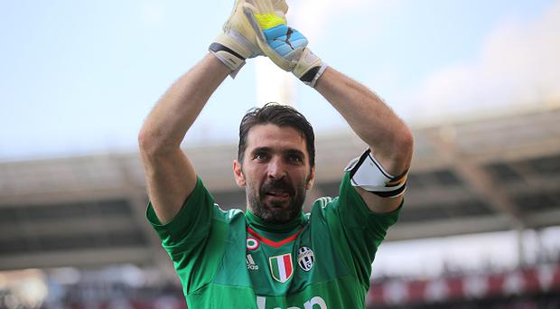 Juventus' goalkeeper Gianluigi Buffon greets fans at the end of the Italian Serie A football match Torino Vs Juventus on March 20, 2016 at the