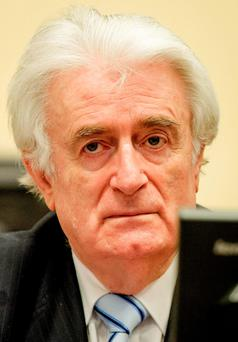 Bosnian Serb wartime leader Radovan Karadzic in the courtroom for the reading of his verdict at the International Criminal Tribunal for Former Yugoslavia (ICTY) in The Hague, The Netherlands. (Robin van Lonkhuijsen, Pool via AP)