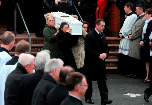 Louise James (front left) who lost her partner, two sons, sister and mother carries a coffin out of the Holy Family church Photo: Brian Lawless/PA Wire