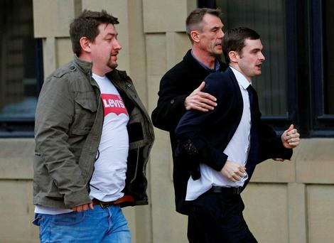 Former Sunderland soccer player Adam Johnson (R) arrives for sentencing at Bradford Crown Court in Bradford today