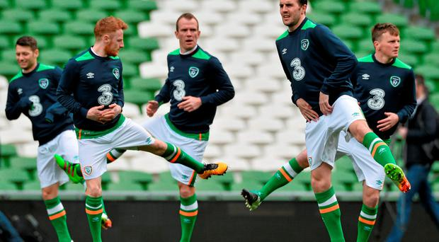 Ireland's John O'Shea, with players from left, Wesley Hoolahan, Stephen Quinn, Glenn Whelan and Stephen Gleeson