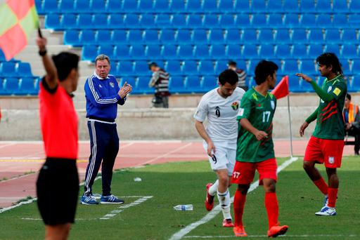 Jordan's national team's coach Harry Redknapp (2nd L) reacts during his team's World Cup 2018 Asian qualifying football match against Bangladesh at the Amman International Stadium in Amman