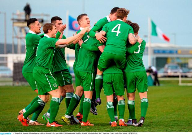 Ireland players celebrate their side's first goal