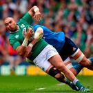 Ireland's Simon Zebo is tackled by Italy's Sergio Parisse. Photo: Ramsey Cardy / Sportsfile