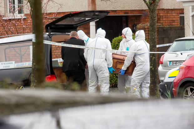 The body of Noel Duggan is removed from the scene. Photo: Colin O'Riordan