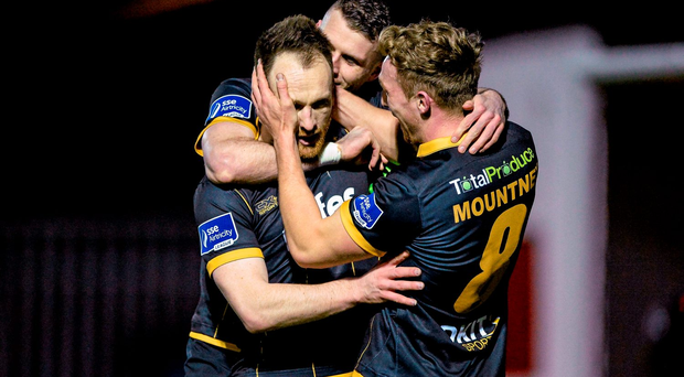Stephen O'Donnell, Dundalk, left, celebrates with team-mates Ciaran Kilduff and John Mountney