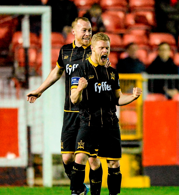 Dundalk's Daryl Horgan celebrates after scoring his team's third goal with team mate Chris Shields