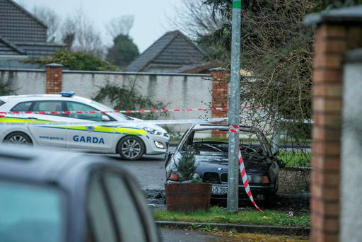The scene of a burnt-out car in Cairn Court, Ratoath, linked to the ganglang killing of Noel Duggan. Photo: Kyran O'Brien