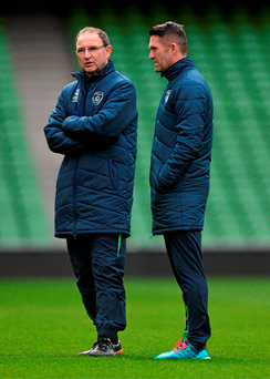 Republic of Ireland manager Martin O'Neill with striker Robbie Keane during squad training at the Aviva Stadium in Dublin yesterday. Photo: David Maher/Sportsfile