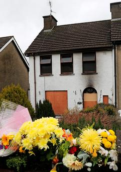 Flowers placed outside the house in Carrickmacross where Gerry Marron died. Photo: Lorraine Teevan