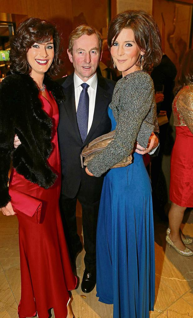 Enda Kenny with sisters Kate O'Connell (left) and Theresa Newman at the annual Fine Gael Presidential dinner in the Burlington in 2013. Photo: Julien Behal/Maxwells