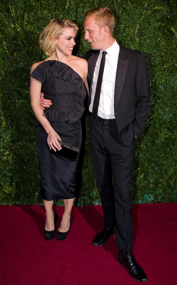 British Actress Billie Piper, shortlisted for the best actress award and her husband Laurence Fox (R) pose on the red carpet as they attend the 60th London Evening Standard Theatre Awards 2014 in London