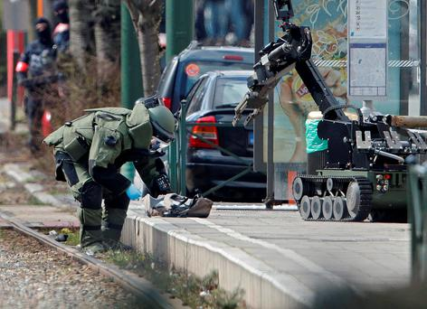 Police use a robotic device as they take part in a search in the Brussels borough of Schaerbeek following Tuesday's bombings in Brussels, Belgium REUTERS/Christian Hartmann