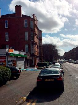 The scene after Asad Shah, a shopkeeper, was found seriously injured outside his premises in Minard Road, Glasgow, on Thursday night and later died in hospital Credit: Lucy Christie/PA Wire