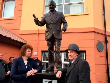 James Connolly Herron (right) unveils a new statue with Northern Ireland Culture Minister Caral Ni Chuilin, for his great grandfather James Connolly, one of the 1916 Easter Rising leaders on Falls Road, Belfast Credit: Lesley-Anne McKeown/PA Wire