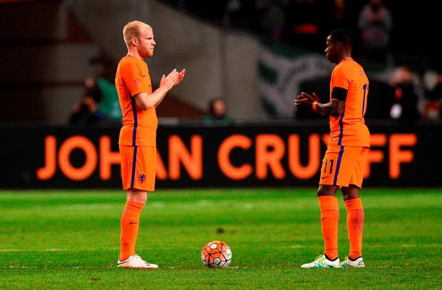 Netherland's midfielder Davy Klaassen (L) and Netherland's midfielder Quincy Promes applaud during a standing ovation in honour of late Dutch football legend Johann Cruyff during a pause in the 14th minute of the friendly football match between the Netherlands and France at the Amsterdam ArenA, on March 25, 2016, in Amsterdam. Cruyff, who passed away on March 24, 2016 at the age of 68 after a battle with cancer, wore the number 14 on his Ajax and Dutch national shirt during his glittering playing career. AFP PHOTO / FRANCK FIFEFRANCK FIFE/AFP/Getty Images