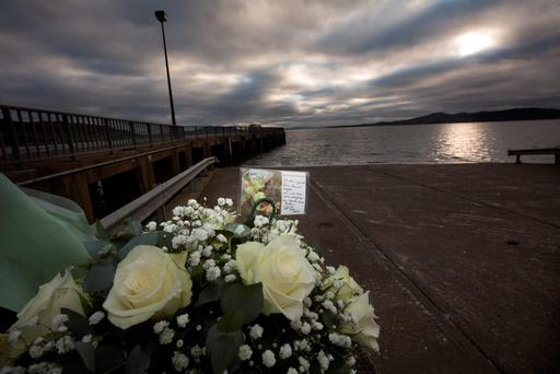 Flowers at the scene where five people drowned in a car that slipped into Lough Swilly in Buncrana, Co Donegal. Photo: Mark Condren