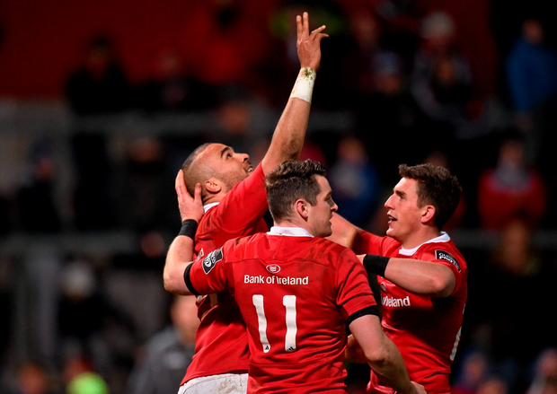 Simon Zebo, Munster, celebrates after scoring his side's second try with team-mates Ronan O'Mahony and Ian Keatley
