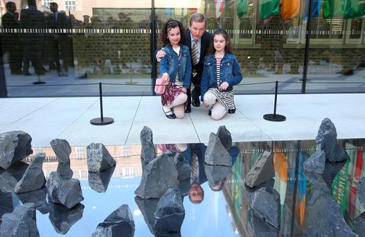 Taoiseach, Enda Kenny with Megan (8) and Laura Jones (10) in front of a memorial titled 'They are of us all' at the opening of the new GPO Witness history Centre. The memorial was created to remember the 40 children killed during Easter week 1916. Photo: Damien Eagers