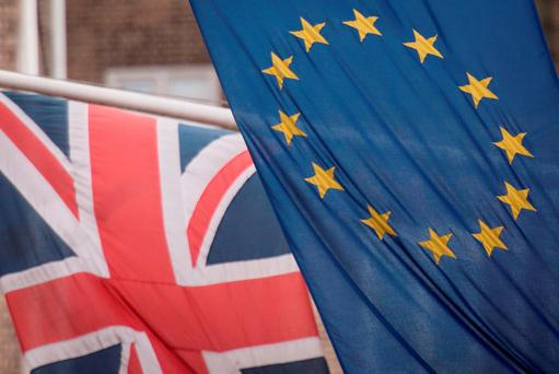 EU and UK flags fly above the EU Commission offices in Westminster. Photo: PA