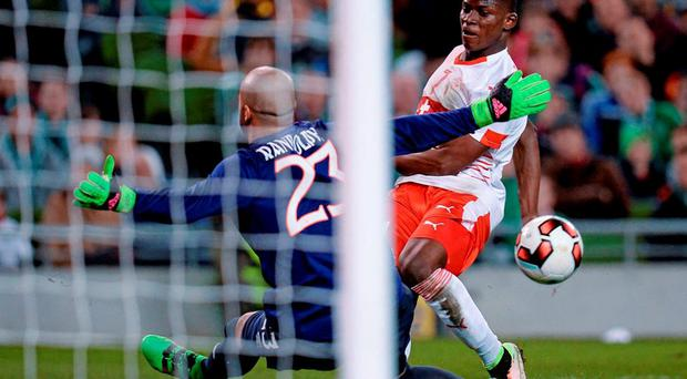 Darren Randolph shuts down the danger against Switzerland's Breel Embol. Photo: Seb Daly / Sportsfile