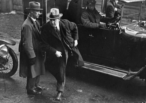 Michael Collins with Joe O'Reilly arriving for the first sitting of Dáil Éireann in 1919. Photo: Independent Newspapers Ireland/NLI collection