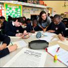 Students from St. John The Evangelist National School in Adamstown Dublin working on a new Proclamation based on the 1916 Proclamation (from left) Jakub Robertson, Aoife O'Driscoll, Gozie Chukwudi, teacher Aoife Rice, Ayo Fatola and Cahill Wan. Photo: Steve Humphreys