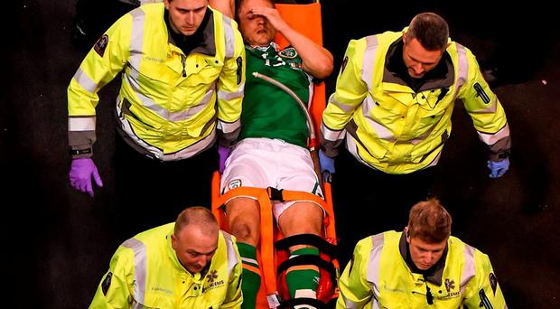 Ireland striker Kevin Doyle is stretchered off the pitch after picking up an injury in last night's friendly against Switzerland. Photo: Cody Glenn / Sportsfile