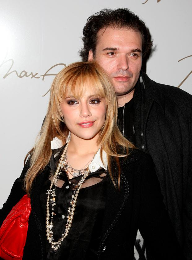 Actress Brittany Murphy and Simon Monjack backstage at the Max Azria 2008 fashion show during Mercedes-Benz Fashion Week Fall 2008 at The Tent at Bryant Park on February 4, 2008 in New York City. (Photo by Andrew H. Walker/Getty Images for IMG)