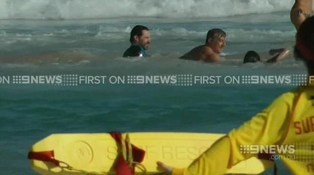 Hugh Jackman rescuing his son Oscar from a rip in Sydney's Bondi Beach. Picture: 9 News
