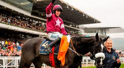 Bryan Cooper celebrates after winning the Timico Cheltenham Gold Cup on Don Cossack with groom Louise Dunne alongside