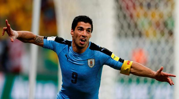 Uruguay's Luis Suarez celebrates after scoring against Brazil during a 2018 World Cup qualifying soccer match at the Pernambuco Arena, in Recife, Brazil