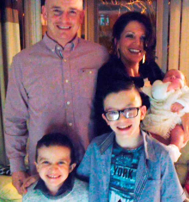 Unimaginable grief: Louise James with partner Sean McGrotty, sons Mark and Evan and baby Rioghnach-Ann who was saved Photo: Family Handout/PA Wire