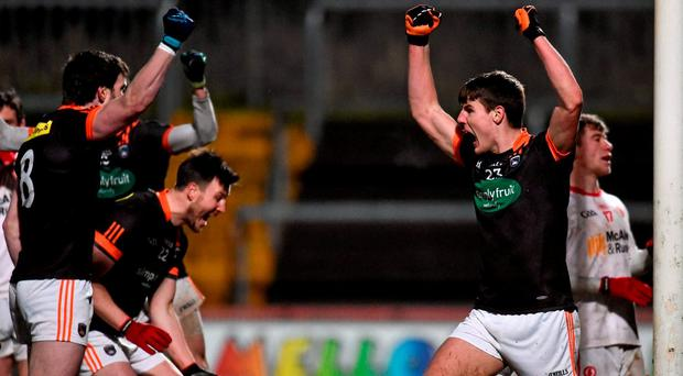 Niall Grimley, right, Armagh, celebrates with team-mates after scoring his side's first goal in the final moments of the game to level the scores. Allianz Football League, Division 2, Round 6, Tyrone v Armagh, Healy Park, Omagh, Co. Tyrone. Picture credit: Paul Mohan / SPORTSFILE