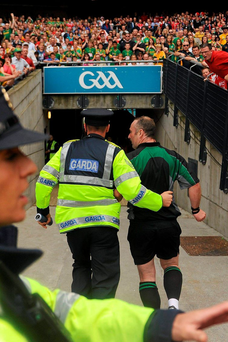 Referee Martin Sludden is escorted off the field after the Meath v Louth Leinster final in 2010 impact Photo: Paul Mohan / SPORTSFILE