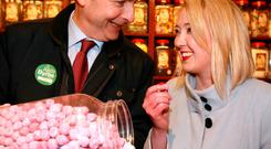 Picking and choosing: Fianna Fail's Micheal Martin with party candidate Aoife Byrne as they sample some of the traditional sweets in Aunty Nellie's Sweet Shop, during canvassing in Wexford Photo: Frank McGrath
