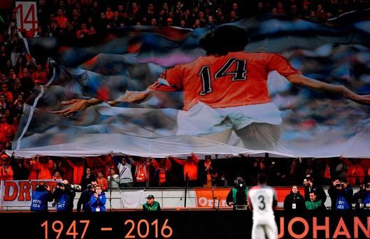Dutch supporters honour the late Johan Cruyff in the friendly international against France on Friday. Photo: Franck Fife/AFP/Getty Images