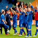 Iceland players celebrate after victory over Netherlands in a Euro 2016 qualifier last September. Photo: Koen van Weel/AFP/Getty Images
