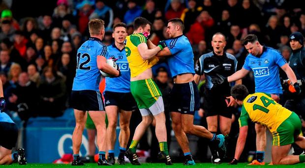 Martin McElhinney squares up to James McCarthy of Dublin in an incident which led to McCarthy and Donegal's Michael Murphy being red-carded during their Allianz League Division 1 clash last night. Photo: Ray McManus