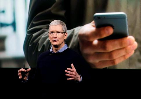 Apple CEO Tim Cook announcing his new products on Monday Photo: AP